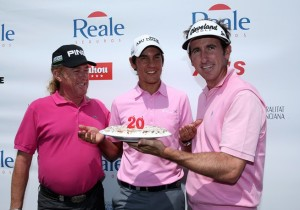 Matteo Manassero of Italy receives a 20th birthday cake from Miguel Angel Jimenez and Gonzalo Fernandez Castano