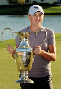 Stacy Lewis of the US, holds up the trop