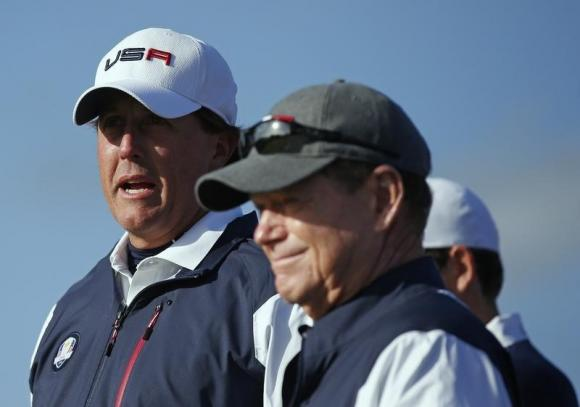 U.S. Ryder Cup player Phil Mickelson stands with captain Tom Watson during his fourballs 40th Ryder Cup match at Gleneagles