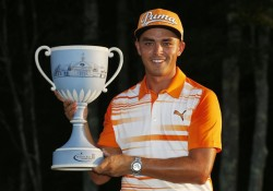 Rickie Fowler holds the trophy after winning the Deutsche Bank Championship golf tournament in Norton, Mass., Monday, Sept. 7, 2015. (AP Photo/Michael Dwyer)