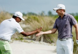 NASSAU, BAHAMAS - DECEMBER 03:  Jordan Spieth of the United States (R) celebrates with Anirban Lahiri of India after a Spieth had a hole-in-one on the second hole during the first round of the Hero World Challenge at Albany, The Bahamas on December 3, 2015 in Nassau, Bahamas  (Photo by Scott Halleran/Getty Images)