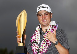 HONOLULU, HI - JANUARY 15:  Justin Thomas of the United States celebrates with the trophy after winning the Sony Open In Hawaii at Waialae Country Club on January 15, 2017 in Honolulu, Hawaii.  (Photo by Sam Greenwood/Getty Images)